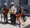 Street band in havana cuba musicians playing instruments for tourists Royalty Free Stock Photo