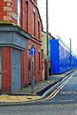 A street of boarded up derelict houses awaiting regeneration in liverpool uk Stock Images