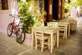 Street cafe in greek town. Crete Royalty Free Stock Photo
