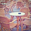 Street cafe wicker chairs in a instagram effect Royalty Free Stock Images