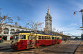 Street car or trollley or muni tram in front of San Francisco Ferry Building in Embarcadero - San Francisco, California, USA Royalty Free Stock Photo