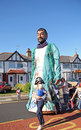 Street carnival tall man photo of a giant model of a fisherman being pushed along in the whitstable oyster festival in kent on rd Royalty Free Stock Images