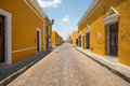 Street in the city of izamal yucatan mexico april view where all buildings are painted a single color yellow throughout Royalty Free Stock Images