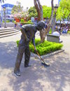 Bronze statue of a street cleaner Royalty Free Stock Photo