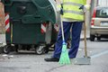 Street cleaning and sweeping with broom process of urban worker dust pan Stock Photo
