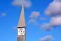 Street clock against a blue sky in the morning with white clouds concept photo of time horizontal Stock Images