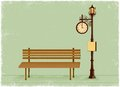 Street clock and lamp post with park bench Royalty Free Stock Photo