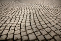 Street with cobblestones background of paved cobble stones Royalty Free Stock Images