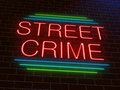 Street crime concept illustration depicting an illuminated neon sign with a Royalty Free Stock Photo