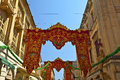 Street decoration in valletta for a religious festival christian banners island of malta july Stock Image