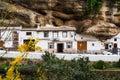 Street with dwellings built into rock overhangs above the rio trejo setenil de las bodegas spain Stock Photo