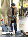 Street entertainer nottingham an elderly with amplified saxaphone busking on clumber in december at nottinghamshire england Stock Photos