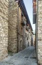 Street of eriste with stone houses located in in the spanish province huesca it s a sunny day with mountain in the background Royalty Free Stock Photography