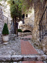 Street in eze village france red pavement stairs with fences and walls of houses a of historical south Stock Photography