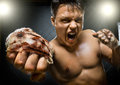 Street fighter horizontal photo muscular young guy cuff fist close up on camera and yell hard light Stock Photo