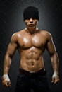 Street fighter vertical photo muscular young guy aggression look hard light Royalty Free Stock Photo