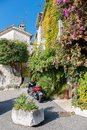 Street with flowers in the old village , France. Royalty Free Stock Photo
