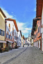 Street in garmisch partenkirchen germany with typical houses Royalty Free Stock Images