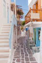 Street of greek island with stairs flowers and street cafe narrow Stock Photography