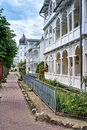 Street with historic houses in the old town of Binz. City on the Baltic Sea coast. Rügen is a popular tourist destination Royalty Free Stock Photo