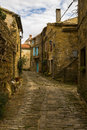 Street in hum detail of al old house old old town croatia photographed at winter afternoon hours Stock Photo