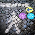Street indication cobblestone with colored Stock Photography