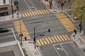 Street intersection a high angle view of an almost empty with yellow cross walk markings traffic signal lights and curb cuts Stock Photos