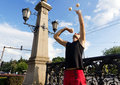 image photo : Street juggler juggling