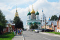 A street in kremlin in kolomna russia people walk on the street dormition church with green and golden cupolas is Royalty Free Stock Images