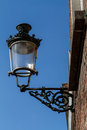 Street lamp in bruges you find this antique lamps hanging longest wall Royalty Free Stock Photos