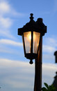 Street lamp detail of an against a blue sky Royalty Free Stock Photo