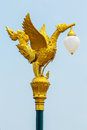 Street lamp golden color mythical female bird sculpture on Royalty Free Stock Photography