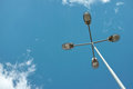 Street lamp industrial device against blue sky in daytime Stock Photos