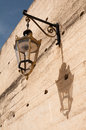 Street lamp and its shadow on a city wall Stock Image