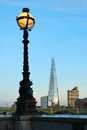 Street lamp and london southwark buildings lit Stock Photo