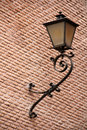 Street lamp mounted on a facade Royalty Free Stock Image