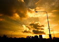 Street lamp in orange sky Royalty Free Stock Photo