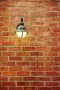 Street lamp on red brick wall Foto de Stock Royalty Free