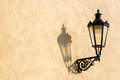 Street lamp with shadow in prague traditional old its on clean wall Royalty Free Stock Images