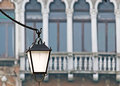 Street lamp in venice detail of a with an antique building the background Royalty Free Stock Photo
