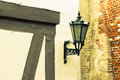 Street lamp vintage against old wall background riga latvia Stock Photo