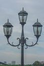 Street lamp on walkway in public park. Royalty Free Stock Photo