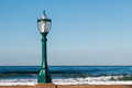 Street Lamp on Wall with Ocean Royalty Free Stock Photo