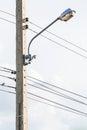 Street lamppost on telephone pole Stock Photos