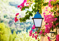 Street lantern with flowers in deia village mallorca baleares spain Royalty Free Stock Images