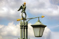 Street lanternon light on the background of the cloudy sky in st petersburg Royalty Free Stock Photos