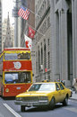 Street level view of wall street with taxi new york city ny Royalty Free Stock Images
