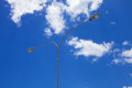 Street light against blue skies background with clouds Royalty Free Stock Photography
