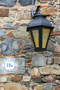 Street light against stone wall in Colonia del Sacramento, Urugu Royalty Free Stock Photo