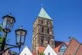 Street light and church tower in Rheine Royalty Free Stock Photo